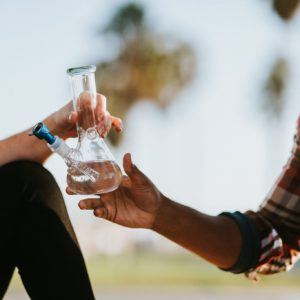 friends passing water bong with blue bowl